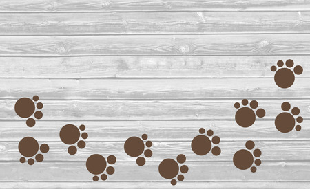 silueta de gato: Paw prints trail on wooden background with copy space for text. Foto de archivo