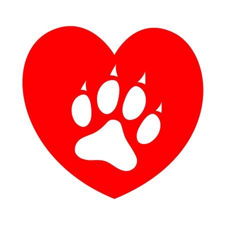 Empreinte de patte de chien sur le symbole de concept de coeur rouge.