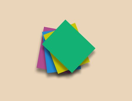 Colorful paper notes stack on beige background with clean space for text.