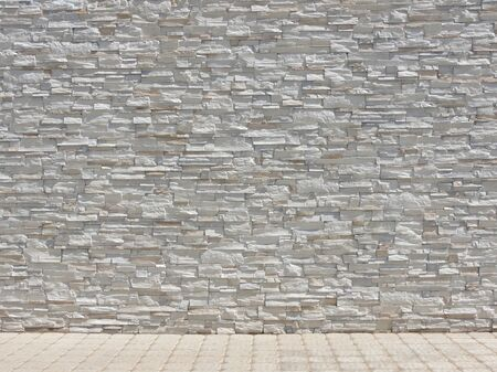 Decorative stone rough wall and tiled floor interior texture background with copy space for your design.