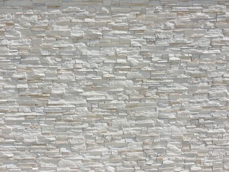 Decorative stone wall texture background banner with clean space for your design. 스톡 콘텐츠