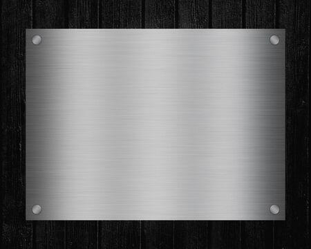 Enseigne en métal brillant avec espace de copie pour le texte sur fond de tableau noir.