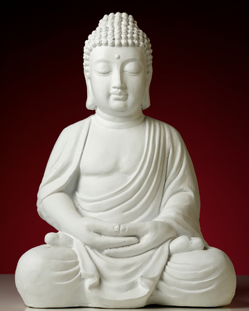budda: Statue of Buddha in lotus position, front view, on a peaceful red gradient background