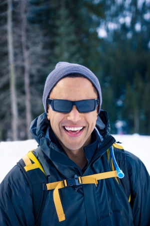 snowshoe: Young black man on snowshoe hike. Stock Photo