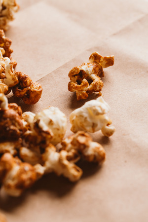 sweet caramel popcorn close-up on light paper. Stock Photo