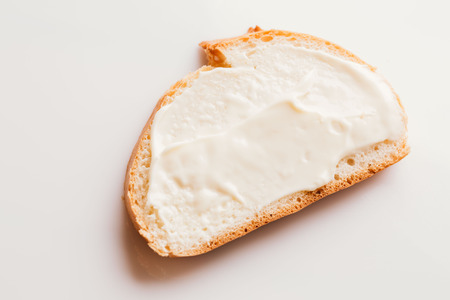 sandwich with creamy melted cheese close-up on a light background. Stock Photo