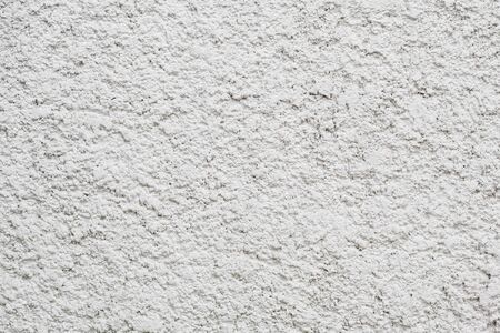 There is white wll with natural rough cement texture Stock Photo