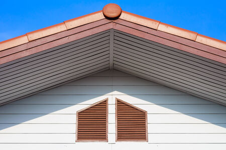 The roof gable with blue sky found in the suburb