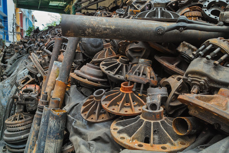 Pile of a lot of used old engine parts for sale in soi of Bangkok downtown, Thailand photo