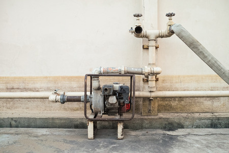 fire extinguishing: Old fire extinguishing system passed the big flood but still working Stock Photo