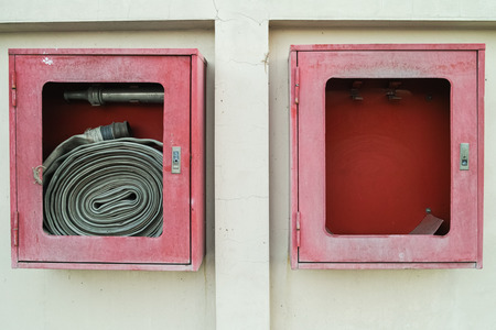 crack pipe: The abandoned old fire hose cases found on the wall shown that not care has been taken of