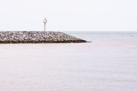 Small lighthouse at the end of coast of Rayong