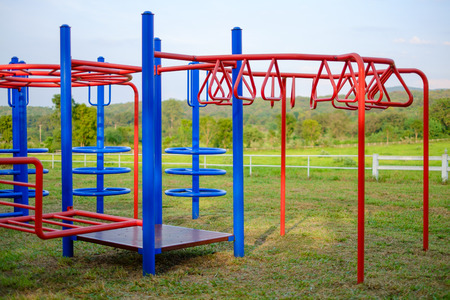 horse stable: Colorful playground in front of the horse stable Stock Photo