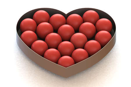 put together: Red Balls are put together in heart shaped metal box