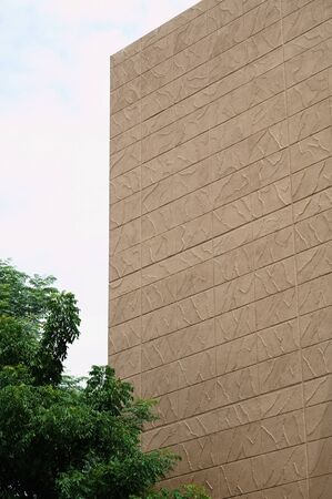 building wall: The building with pattern of Terracotta Stucco Wall