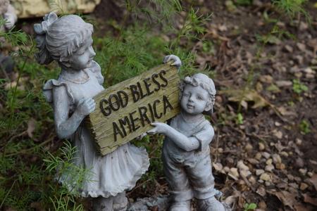 god bless: figurine of GOD bless America