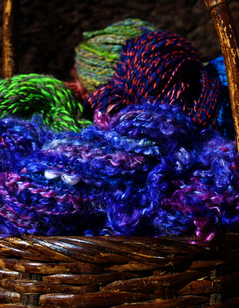 overflows: Colorful hand spun yarn from a true artist and fresh dyed wool overflows from a basket.