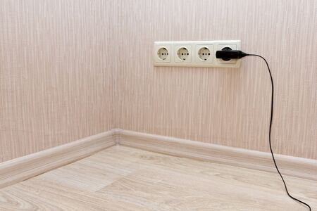 electrical outlets in the corner of a room photo