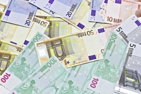 disarray: many euro banknotes of different denominations are in disarray