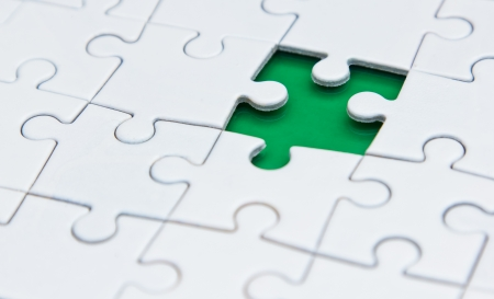 missing one piece of the puzzle on a green background photo