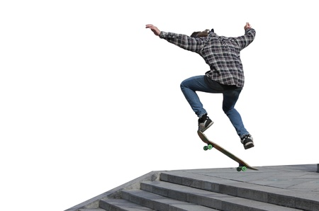 young skateboarder jumping on a white background photo
