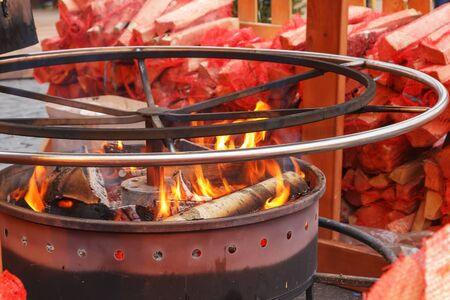 brazier: in the round a brazier burning firewood