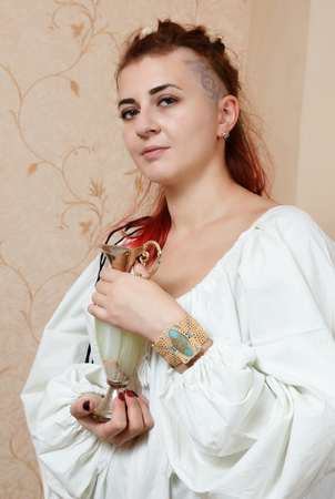 The girl shows ornaments from macrame Stock Photo