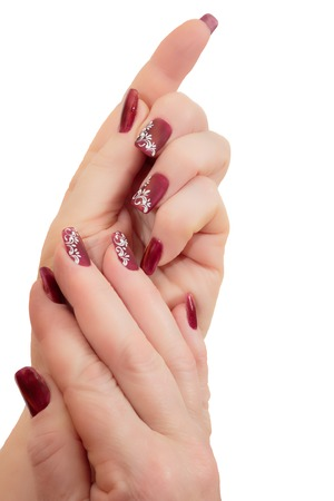 Female hands with manicure on a white background