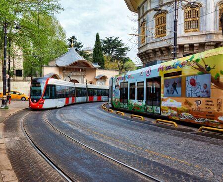modern high-speed tram on narrow street Istanbul