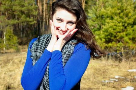 sweetly: The woman smiles sweetly