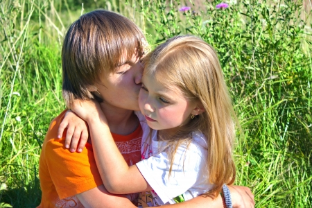 Brother and sister hugging each other photo