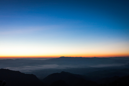 sky rise: Sun rise with blue and orange sky in the morning Stock Photo