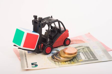hauling: Toy forklift hauling a multicolor cube with coins and euro notes
