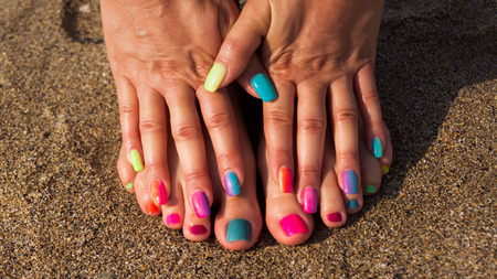 anklebone: Pedicure and manicure with colorful  nails