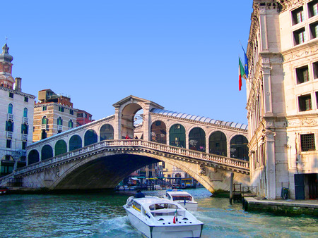 clock of the moors: The Rialto Bridge over the Grand Canal in Venice Italy Editorial