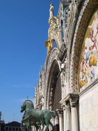 clock of the moors: Horses on the Facade of the cathedral of St Marks in Venice Italy Editorial