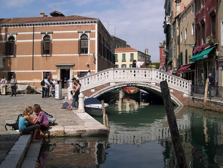 clock of the moors: Side Canal in Venice Italy