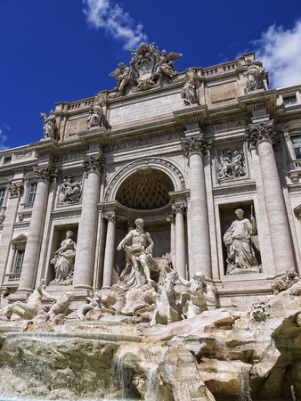 The restored Trevi Fountain in Rome Italy.The Trevi Fountain was finished in 1762 and was designed by Nicola Salvi. It is believed that if you throw a coin in the fountain you will return to Rome.