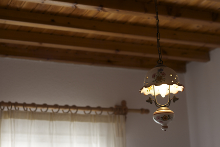 wooden  ceiling: Electric lamp, curtains and wooden ceiling