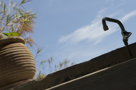 clay pot: Clay pot and a water tap with nice sky view