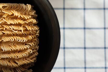 instant noodle: Instant Noodle in a bowl on a table Stock Photo