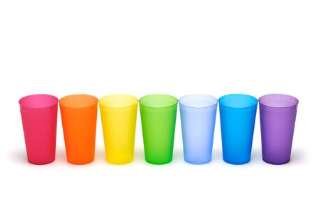 Group of bright plastic cups, rainbow colors, white background Stock Photo