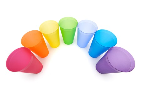 Group of bright plastic cups, rainbow colors, white background 写真素材