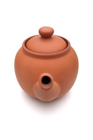 Ceramic teapot on a white background photo