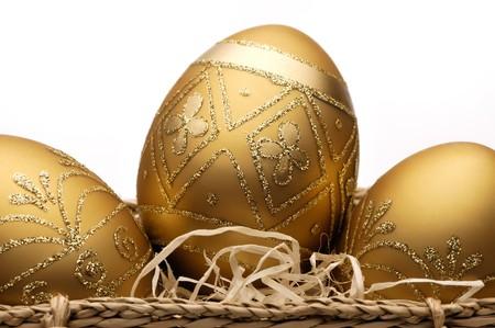 golden egg: Group of golden easter eggs