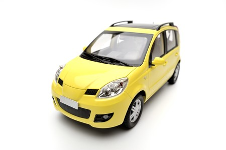 Generic modern yellow family car model on a white background, isolated