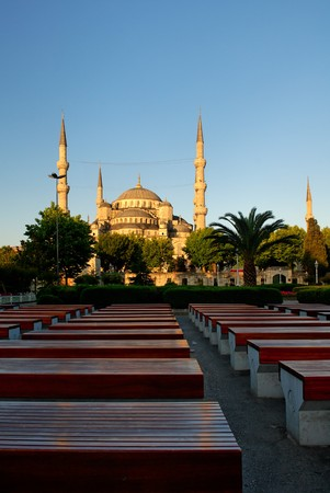 Blue Mosque at sunrise, perspective rows of benches in foreground photo