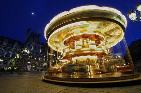 Carousel near  Paris, France. Rotating, full speed. 版權商用圖片