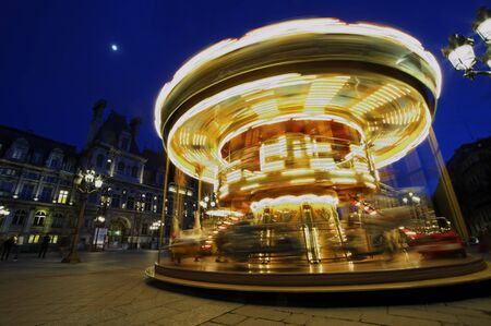 Carousel near  Paris, France. Rotating, full speed. Stock Photo