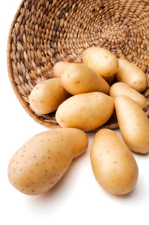 Fresh potatoes in a basket, white background